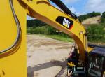 Caterpillar backhoe working on construction site