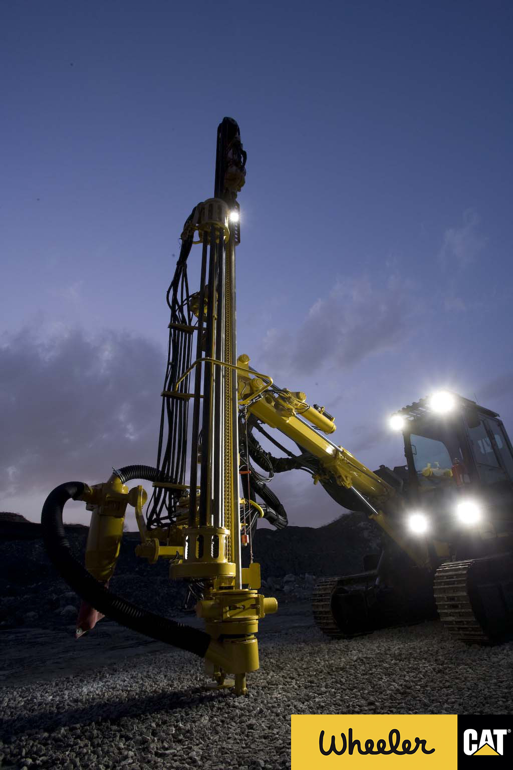 MD5150 Track Drill at dusk with lights